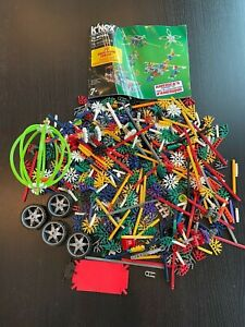Lot of K'Nex Building Connectors Parts Pieces Sticks Idea Book Wheels
