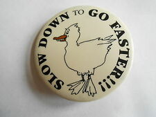 Cool Vintage Slow Down to Go Faster Fun Slogan Smiling Duck Pinback
