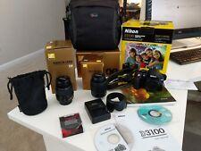 Nikon D D3100 14.2MP DSLR Kit with 18-55mm and 55-200mm zoom lens + Camera Bag