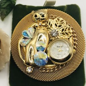 Bonetto cat brooch with a watch and Swarovski crystals