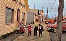 Nome Alaska Main Street Scene Natives Vintage Postcard K50444