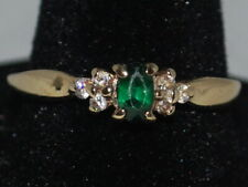 10k Gold ring with an Emerald(May birthstone) and CZ's
