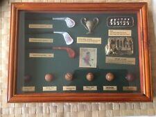 Vintage golf items in display case