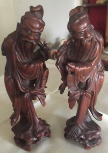A pair of finely carved Chinese hardwood fishermen figures C.1875