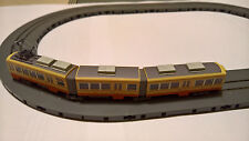 Tracciato con tram Tomytec con chassis TM-TR06 in scala N e trasformatore