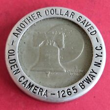 1976 ANOTHER DOLLAR SAVED OLDEN CAMERA NEW YORK DOLLAR WITH ADVERTISING SURROUND