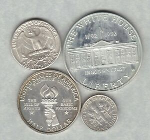 FOUR USA SILVER COINS 1962 TO 1993S IN EXTREMELY FINE TO NEAR MINT CONDITION.