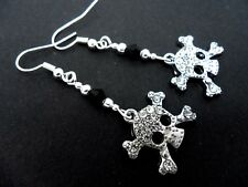 A PAIR DIAMANTE RHINESTONE & BLACK CRYSTAL DANGLY SKULL EARRINGS. NEW.