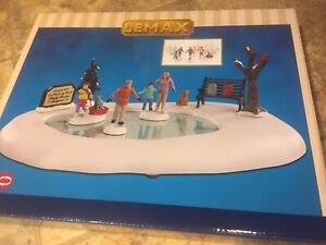 Lemax FAMILY SKATING DAY -animated Holiday Village Pond With Accents-9 Piece Set