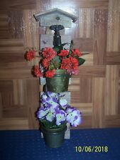 Rustic Double Wall Planter featuring 2 planters and decorative faucet