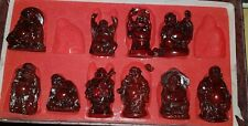Set of 10 small red resin buddhas
