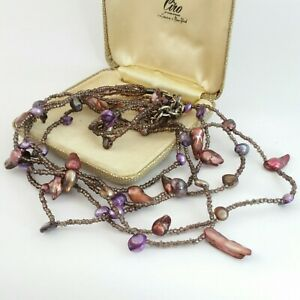 Multi strand shell and glass bead necklace