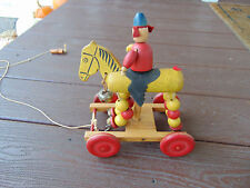 VINTAGEROLLING HORSE AND RIDER WOODEN PULL TOY. REALLY NEAT TOY