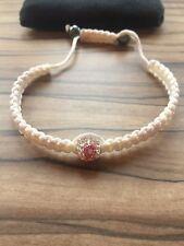 Tresor Paris 'pink ribbon' white woven bracelet
