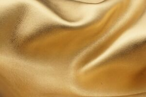 Gold leather sheets with metallic look. Premium golden color nappa leather piece