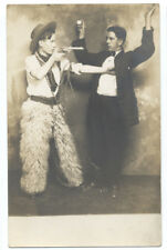 Studio RPPC - COWBOY Points GUN & ROBS A MAN ca1908