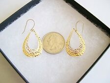 A Pair of 14k Yellow and White Gold Teardrop Dangling Earrings