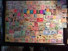 125 Queen Elizabeth II Commonwealth stamps off paper all different freepost.