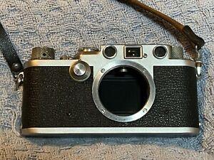 Leica IIIf rangefinder 35mm camera + lenses, tripod, case, light meter & more