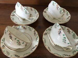 4 Antique semi porcelain tea cups and saucers - cream glaze, with gilding
