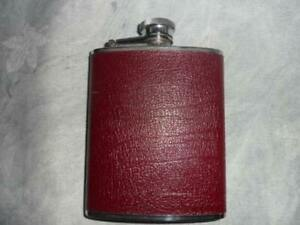 BURGUNDY LEATHER CLAD 6 OZ HIP FLASK DATED 1985
