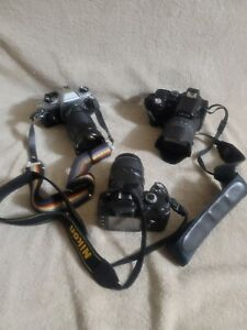 lot of 3 cameras 2 nikon fg,d40x 1leica v lux 1Sold as is