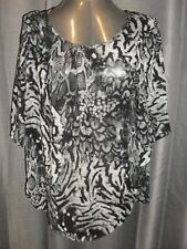 Millers size 16 black & white printed short sleeved polyester top in VGC