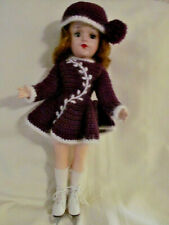 Vintage, hard plastic: Mary Hoyer doll, with knitted purple ice skating outfit