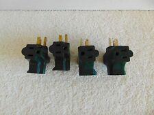 Four green 3 Way Plug Cord Adaptors