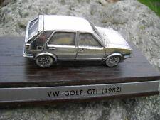 MODELLINO AUTO VW GOLF GTI (1982) SILVER PLATE nuovo