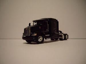 DCP FIRST GEAR 1/64 BLACK KENWORTH T660 WITH 72'' FLATTOP SLEEPER