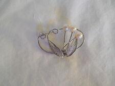 Lovely filigree silver tone w/faux pearl brooch