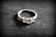 3-Stone Platinum Certified Diamond (0.43ct. F/SI2 CENTER STONE) Engagement Ring