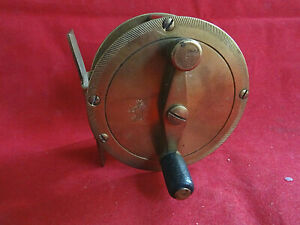X RARE VINTAGE 1920/30'S DAM BRASS CRANK WIND REEL WITH EARLY D.A.M. GOAT MARK