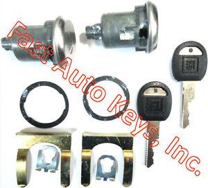 NEW PAIR CHEVROLET GM OEM PAIR DOOR LOCK SET KEYED CYLINDER W/2 OEM GM LOGO KEYS