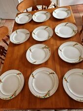 More details for art deco dinner service. cream with orange designs. good condition for its age.