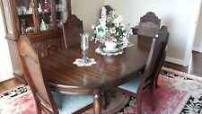 medium oak dining room table with six chairs, buffet cabinet and glass hutch