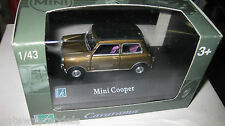 CARARAMA  MINI COOPER GOLD WITH BLACK ROOF OPENING DOORS  1/43 DIECAST OLD STOCK
