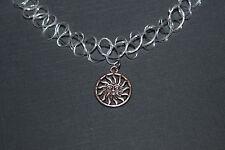 clear stretchy tattoo choker necklece with round sun Tibetan silver charm- retro