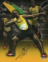 OLYMPICS USAIN BOLT SIGNED AUTO 11X14 JAMAICA PHOTO AUTHENTIC BECKETT BAS COA 28