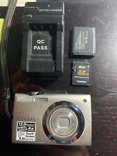 NIKON COOLPIX S4000 12.0 Mega Pixels Silver Digital Camera and accesories.