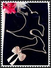 Gold Tone Long Chain Necklace & Ribbon Bow Rhinestones Pendant,