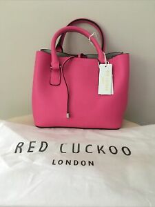 Red Cuckoo handbag and shoulder strap in hot pink with dust bag new with tags