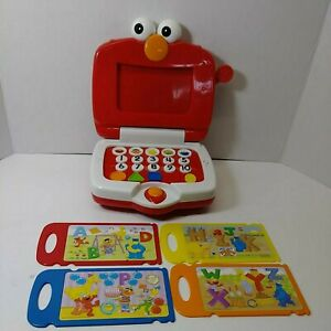 Elmo's Learning Fun Laptop  With 4 Double-sided Disks