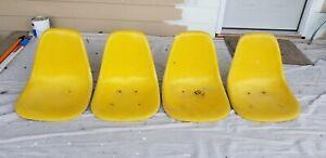 4 Eames Herman Miller Yellow mid century modern fiberglass shell chairs w/ holes
