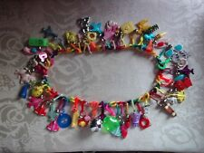 AUTHENTIC 1980'S RAINBOW PLASTIC NECKLACE w/49 CHARMS & BELLS - NEW OLD STOCK