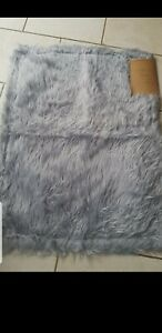 Brand new Gorgeous Mongolian Faux Fur Silver Rug 70x90cm Silver rug .