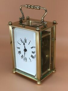 Antique brass carriage clock & key. Fully restored and serviced in Sept. 2021.