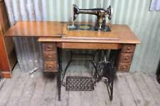 A Singer Treadle Sewing Machine in Oak Cabinet c.1923