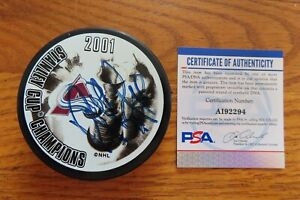 HOFer RAY BOURQUE signed 2001 STANLEY CUP CHAMPS Puck PSA COLORADO AVALANCHE